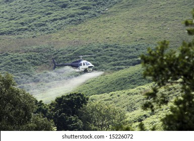Crop sprayer duster helicopter, spraying mountains, fields and land