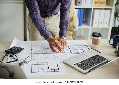 Croped image of architect drawing construction plan for building project