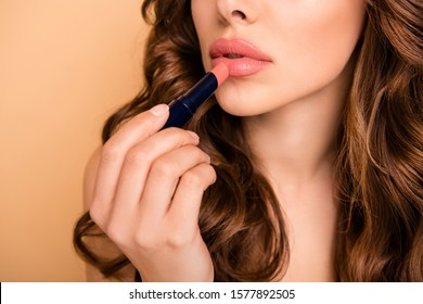 Cropped close up photo of focused girl apply her pomade have beauty cosmetologist treatment prepare for date isolated over pastel color background