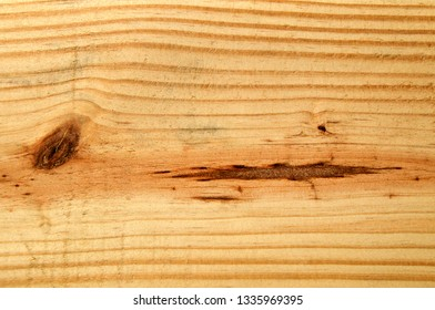 Cropped close up of plain pine plank board showing grain and knots