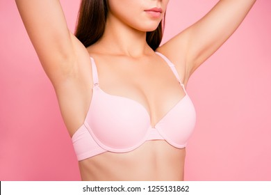 Cropped close up portrait of tenderness gentle she her woman with perfect lovely decollete in pale pink bra showed on first plan isolated on rose background