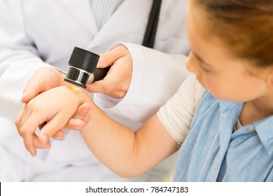 Cropped close up of a young girl having her moles checked by a professional dermatologist using dermatoscope copyspace skin cancer awareness examination appointment medicine