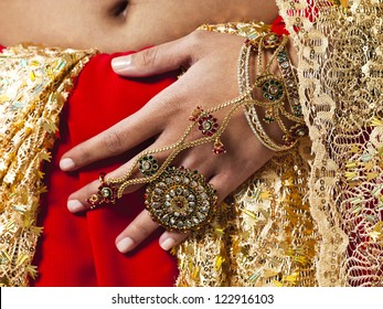 Cropped close-up image if a woman in traditional Indian bridal dress