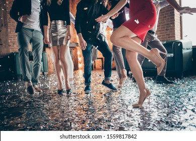 Cropped closeup photo of slim perfect legs girls guys meeting rejoicing dance floor x-mas party glitter flying wear luxury formalwear red dress silver skirt pants restaurant indoors