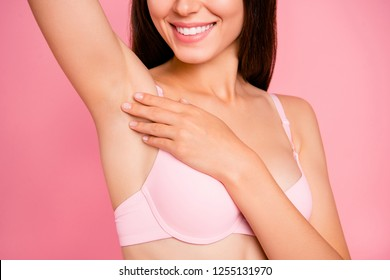 Cropped close-up portrait of nice lovely delicate winsome attractive cheerful girl in beige bra touching enjoying clean clear soft smooth arm-pit skin isolated over pink pastel background