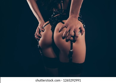 Cropped close-up rear back behind view of alluring sportive perfect fit thin shape form line lady wearing swordbelt teasing posing holding in hands gluteal isolated on black background
