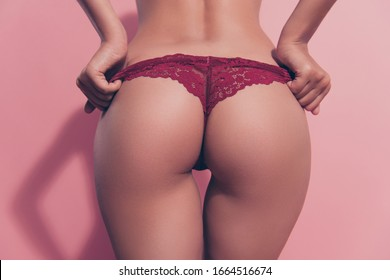Cropped close-up rear back behind view of nice thin fit babe lady girlfriend wife posing perfect flawless round sportive curvy line figure erotica putting panties off isolated over pink background
