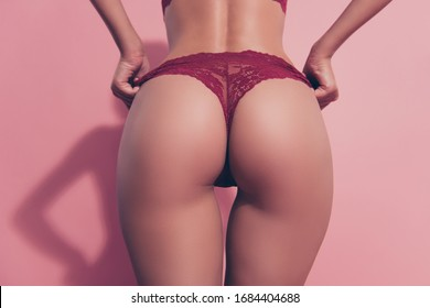 Cropped close-up rear back behind view of nice thin fit adorable babe lady girlfriend wife posing perfect flawless round shape sportive curvy line figure tease erotica isolated over pink background