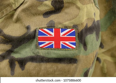 Cropped closeup shot of a UK flag on a soldier's uniform