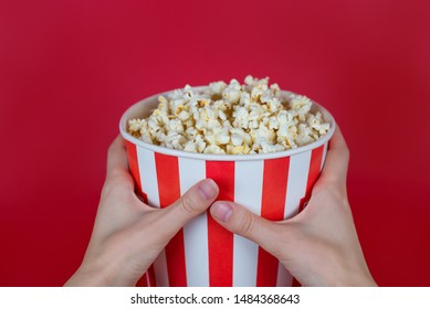 Cropped close-up top above overhead high angle view photo of tasty yummy delicious fresh container with popcorn isolated bright background