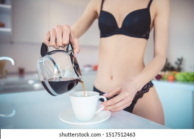 Cropped close-up view of her she naked nude attractive sporty sportive perfect girl pouting coffee porcelain cup waking up early time regime in modern light white interior kitchen house indoors
