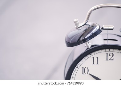 Cropped and closeup  vintage alarm clock for time management concept