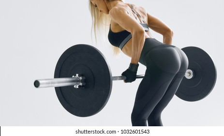 Cropped conceptual inspiration lifestyle photo of female fitness model workout Perfect trained body chest booty legs arms chest Confident blonde woman weight lifting workout at gym