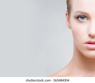 Cropped face of a beautiful woman with blue eyes. Skin care concept.