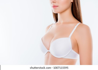 Cropped half-turned closeup photo of healthy big stunning seductive woman's breast dressed in white bra flawless soft elegant gentle nice skin skinny arms isolated on background copyspace
