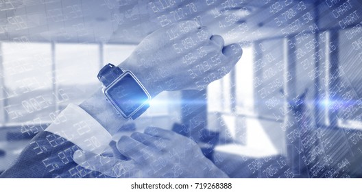 Cropped hand of businessman wearing smart watch against stocks and shares