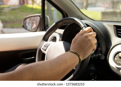 Cropped hands of man holding steering whee
