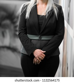 Cropped head Business Woman in corporate attire with hands in front