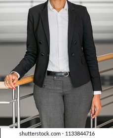 Cropped head Business Woman in corporate attire in an office environment