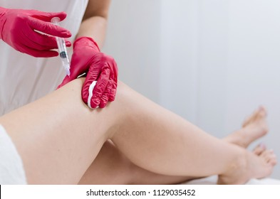 Cropped high resolution photo of thigh injection , body shaping treatment.