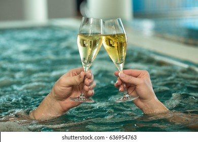 Cropped horizontal shot of a couple toasting with their champagne glasses while relaxing in the jacuzzi tub copyspace love celebrating affection honeymoon spa service luxury lifestyle happiness fun