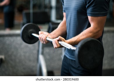 Cropped image of athlete holding heavy barbell
