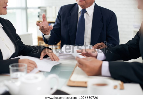 Cropped image of attorney talking to his team