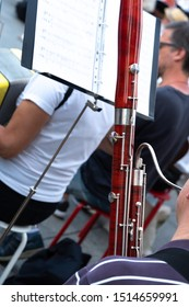 Cropped image of a back turned man playing the bassoon