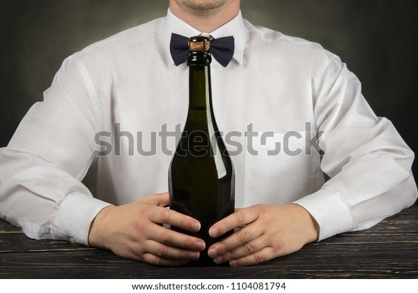 Cropped image of bartender pouring champagne into glass at bar counter
