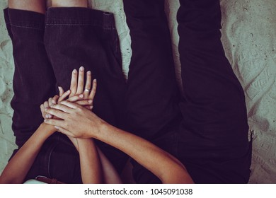 Cropped image of beautiful young couple holding hands