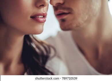 Cropped image of beautiful young couple. Close up of two lovers are going to kiss.