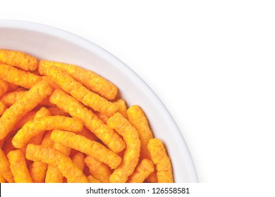 Cropped image of bowl of cheese puffs against white background