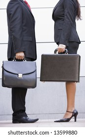 Cropped image of business meeting outside modern office