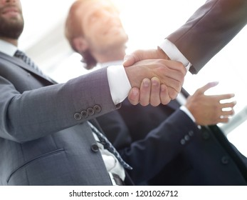 Cropped image of business people shaking hands