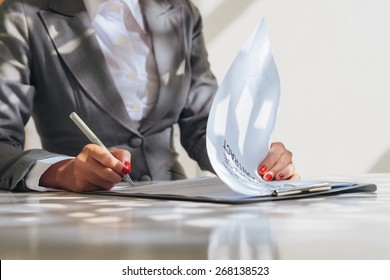 Cropped image of business woman signing contract