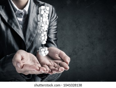 Cropped image of businessman in suit presenting multiple cubes in form of exclamation mark in his hands. 3D rendering.