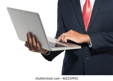 Cropped image of businessman use of the notebook computer over white background