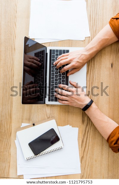 cropped image of businessman working on startup project in office with laptop