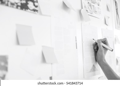 Cropped image of businessman's hand writing on paper in office