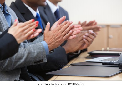 Cropped image of businesspeople clapping