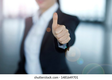 Cropped image of businesswoman showing thumb up