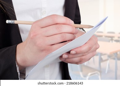 Cropped image of businesswoman writing on white paper