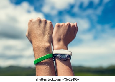 Cropped image of couple fists in the sign on strength and power with sky nature background