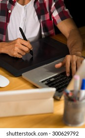 Cropped image of designer using professional graphic tablet at work
