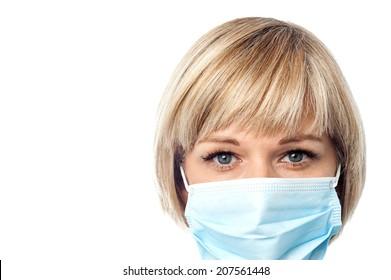 Cropped image of female physician wearing medical mask