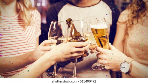 Cropped image of friends toasting with beer and wine against flying colours
