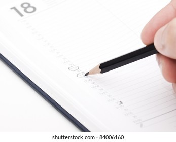 Cropped image of hand  taking notes