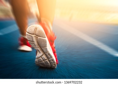 Cropped image of handsome man running, back view/close up shoe run for running,Close-up view while running, rear view / short running shoes for running, exercise, jogging