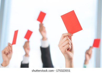 Cropped image of human hands declining something showing red card on the foreground