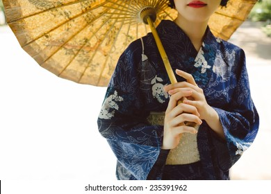 Cropped image of Japanese girl wearing traditional kimono